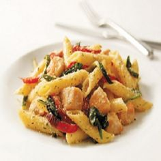 Chicken-Pasta Primavera Recipe Main Dishes with penne pasta, olive oil, boneless skinless chicken breasts, baby spinach leaves, red bell pepper, zucchini, italian seasoning, rosemary