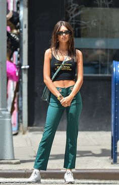 Emily Ratajkowski shows some skin in a tiny Quentin Tarantino crop top and green trousers in NYC Emily Ratajkowski Outfits, Emily Ratajkowski Casual Style, Emily Ratajkowski Street Style, Celebrity Casual Outfits, Outfit Look, Sexy, Summer Outfits, Celebs, Fashion Outfits