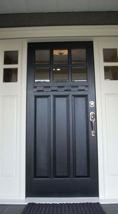 Front Doors / High wooden doors with windows on top, light in and privacy! I would probably still go with a dark wood.