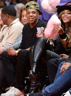 Spirited attendee: As the 33-year-old Single Ladies has recently hinted at a pregnancy, she seemingly dashed those hopes as she enjoyed what looked like a clear alcoholic beverage while sitting courtside