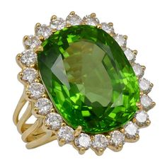 Peridot Gold Cocktail RFabulous striking large peridot cocktail ring set in 18k gold. Fine brilliant color.. Faceted peridot weighs 20cts surrounded by 1 1/2cts of full cut luminious diamonds.ing |