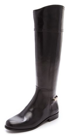 I love when styled riding boots like these with the different heights on the sides of these from Tory Burch