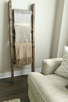 Beautiful rustic wood blanket ladder. I love these ladders because they look good in almost any space, it's great to keep a few blankets close to grab when you need it. I think i love more being able to see all my beautiful blankets rather then storing them in a closet! #ad #farmhouse #blanketladder