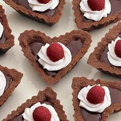 Valentine Hearts Chocolate-Raspberry Tartlets - are filled with ganache, a rich, smooth mixture of melted chocolate and cream. A dash of framboise, an eau-de-vie (clear brandy) made from raspberries, imparts a refreshing fruit flavor to the ganache. Gourmet Recipes, Dessert Recipes, Raspberry Recipes, Raspberry Tarts, Valentines Day Food, Valentine Hearts, Chocolate Desserts, Raspberry Chocolate, Chocolate Tarts