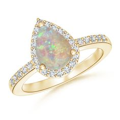 Make a statement with this Pear Shaped Opal Ring with Diamond Halo from Angara.com. Explore a fascinating array of designs
