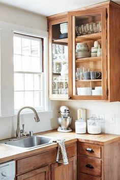 Modern Kitchen Interior Remodeling cute natural wood kitchen cabinets - A glimpse inside this historic home's modern revamp. Natural Wood Kitchen Cabinets, Farmhouse Kitchen Cabinets, Kitchen Wood, Diy Kitchen, Country Kitchen, Kitchen Cupboards, Kitchen Corner, Vintage Kitchen Cabinets, Craftsman Kitchen
