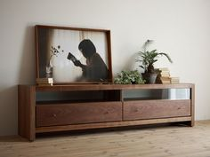 This is GORGEOUS!!! simple lines...beautiful wood. My handy husband has to make this for our living room.