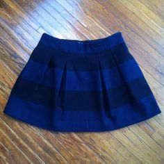 Madewell Striped Pleated Skirt with Pockets Black and navy stripes. 65% wool/35% polyester. Side zipper closure. Pockets on both sides. Lining 100% polyester. Gently used condition. Be sure to check out the rest of my closet! I offer a discount on bundled items! Madewell Skirts