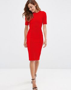 What to wear to a wedding: A form-fitting red dress.