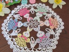 EASTER BUNNYS, BASKETS HAND CROCHET DOILY, BY ME More