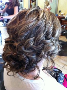 Loose braid. Looks sweet. Maybe done with half the hair then the bottom half in loose curls - gorgeous!