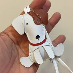 measures: 7.5 cm X 4 cm handcut,hand stitched,handmade This lovely Jack Russell charm is designed and handmade by us, We name it Tino This is as picture shown, No custom request or change color, thank you :) This listing is for one small size Jack Russell charm only, bag is not