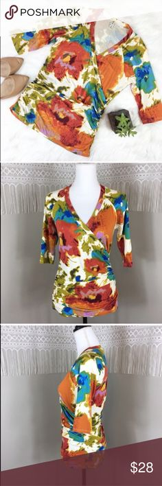 CAbi Floral Print Faux Wrap Style Blouse CAbi Floral Print Faux Wrap Style Blouse. Size medium. Approximate measurements flat laid are 23' long, 16 1/2' bust, 17' sleeve from collar. GUC with no major flaws. Beautiful print for fall! ❌No trades ❌ Modeling ❌No PayPal or off Posh transactions ❤️ I 💕Bundles ❤️Reasonable Offers PLEASE ❤️ CAbi Tops Blouses