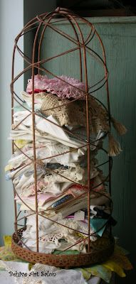lovely way to display old linens and lace.