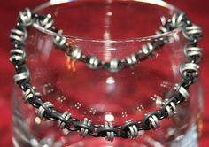 Black and Silver Barrel Weave Braclet - Adjustable Size due to Rubber O Rings. CURRENTLY OUT OF STOCK