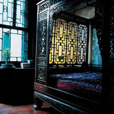 opulance defined by an antique Chinese bed