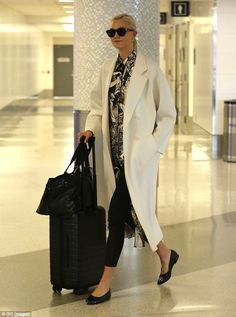 Airport chic! Karlie Kloss showed turned an airport terminal into a fashionable affair as ...
