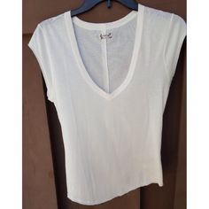 Intimately Free People V-Neck Tee Ivory FP tee. Bought at Nordstroms with the hole on the left shoulder. Never worn Free People Tops Tees - Short Sleeve