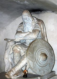 Forever in a cellar... Holger Danske, also known as Ogier the Dane, was a legendary Danish warrior and knight in Charlemagne's army. The statue is made by H.P. Pedersen-Dans, and is found in the cellar (kasematterne) of Kronborg Castle, Denmark. Here he sleeps until Denmark is in danger and needs his help.