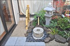 small space Japanese garden.  How to raise the soli level  up to sgd.  Good use of different types of rock/gravel