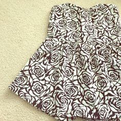 NWOT pins &needles peplum top Beautiful black & white rose designed peplum shirt with back strapped details. Never before worn by owner. Size xs, great condition. No trades Urban Outfitters Tops