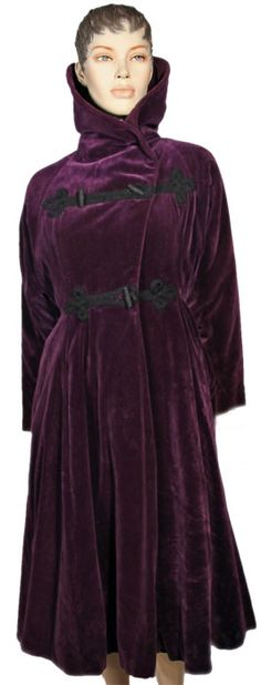 1930's Deep purple rayon velvet with black satin faille lining. Bold cowl collar, mutton sleeves, flared from the waist down.  Ballyhoovintage.com