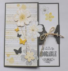 Absolutely stunning! The grunge background is awesome, the tag closure is neat and I love the little butterflies too.
