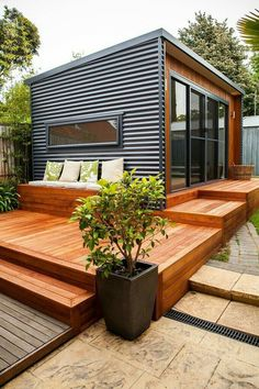 Container House - Deck idea - I like the horizontal metal and wood combo! - Who Else Wants Simple Step-By-Step Plans To Design And Build A Container Home From Scratch? Building A Container Home, Container House Design, Tiny House Design, Container Garden, Home Design, Container Van House, Wood House Design, Building A Tiny House, Container Flowers