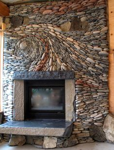 AMAZING FIREPLACE STONEWORK - BEAUTIFUL SWIRLING PATTERN WITH RIVER ROCK OVER THE HEARTH!