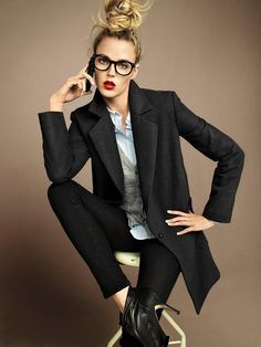menswear inspired -  sleek and sexy.  love the top knot, big horned rimmed glasses, black skinnies with button down shirt and vest