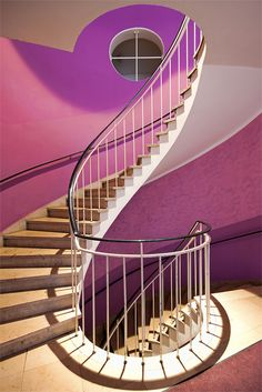Pink wall colors makes the staircase more attractive.