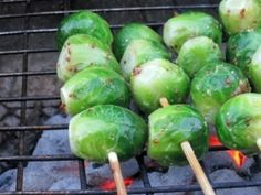 GRILLED BRUSSELS SPROUT.  Need to do this camping.  Just brush with oil and salt and pepper them.