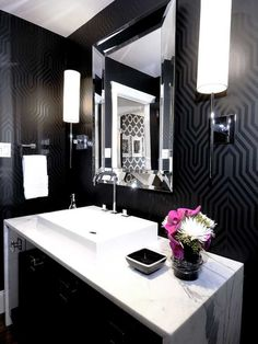 Love interesting wall paper in a powder room. It looks very elegant and classy.
