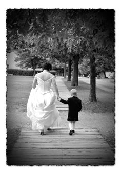 My nephew Matthew in a kilt walking with the bride.   Love this one.... & I love this kid! and the bride, too!