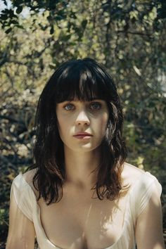 """Zooey Deschanel...""""There are short girls, tall girls, big girls, and small girls...but the best kind of girl....is a quirky girl."""""""