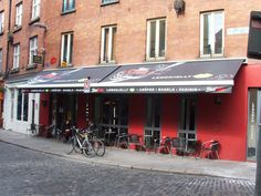 Bright red walls and a large retractable awning makes this cafe stand out from the crowd #kerb #appeal