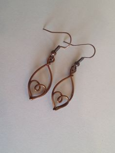 These earrings are handcrafted from copper wire in the shape of a small heart. At about 1.5 theyre dainty, lightweight, and cute. Also, they