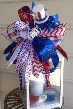 Patriotic lantern,4th of July lantern,memorial day lantern,Labor Day lantern show your American pride with this bright white lantern decorated in a patriotic theme so it can be used for all patriotic holidays or all the time just to show you support it has a flamless flicker candle that has a timer on it the swag can easily be removed and packed away and another holiday theme tied on I also sell in my shop the lantern measures 18in high 12 in wide and 7 in deep