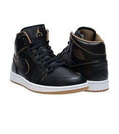 Air Jordan 1 Mid Black Metallic Gold Whites 1 Mid sneaker Men's mid top Lace up closure Padded tongue with AIR JORDAN jumpman logo branding detail NIKE swoosh on sides of shoe Cushioned inner sole for