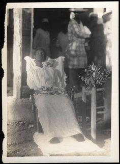 Rare PM portrait of a black woman outside.
