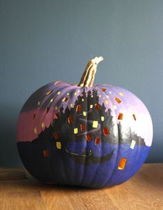 Taken from a scene in the Rapunzel-inspired movie, this pumpkin decor will help you see the light. See more at Lish Concepts » - CountryLiving.com