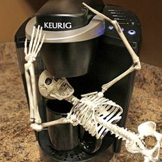 A Halloween Tradition! Our Skeleton is up to his usual tricks! Hope he doesn't drink all the coffee!