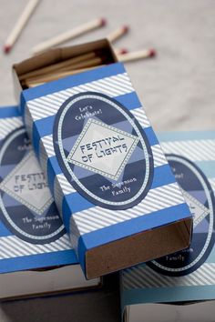 Chanukah DIY gifts: personalized matchboxes and candles. We love this idea!