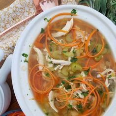 """Delicious Crock-Pot Chicken Carrot """"Noodle"""" Soup - chicken broth/stock, celery, yellow onion, garlic clove, bay leaves, dried/fresh thyme, chicken breasts, carrots"""