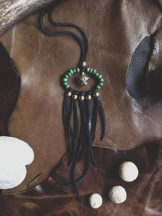 midnight rider.  a black and turquoise fringe by RootsandFeathers, $54.00