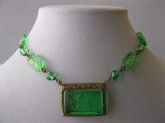 A 1930's Czech Art Deco peridot glass necklace.