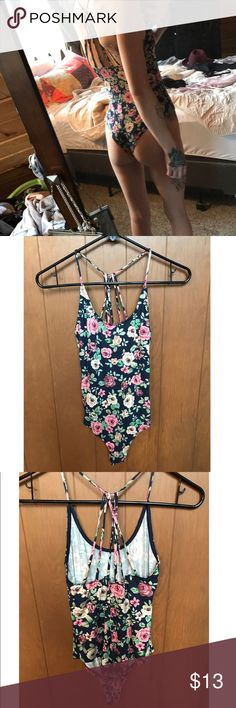 "NWOT Urban Outfitters Floral Strappy Bodysuit NWOT Floral printed bodysuit. Size small. Scoop neckline, exposed straps back, snaps at the crotch.  Style it with some vintage jeans or a mini skirt for a summer look! Brand new, only worn for these photos. Originally $47 online at Urban Outfitters but is currently out of stock.   For reference, model is a size XS-S, waist size 24, bust 32, and 5""4 height.   Tags: #urbanoutfitters #uo #floral #bodysuit #small #strappy #summer #leotard #onepiece…"