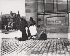 c.1890, Fishwives selling fish on the corner of Neville Street and Forth Banks, Newcastle upon Tyne | Lantern Slide, the women are standing on a street corner in front of a large building with their baskets at their feet. A horse-drawn tram can be seen in the background to the left ~ Newcastle Libraries, Flickr.