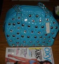 $15.99 Studded Purse with silver half moons Blue Turquoise color, water resistant, easy to wipe clean. Very Unique purse.