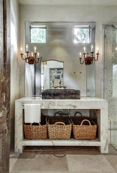 We love the   juxtaposition of the white, modern marble vanity's clean edges with the aged patina and rich color of the Belgian Blue sink (from our collection) in this powder room.